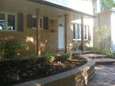 Concrete porch veneered with pavers, garden wall, walkway and steps