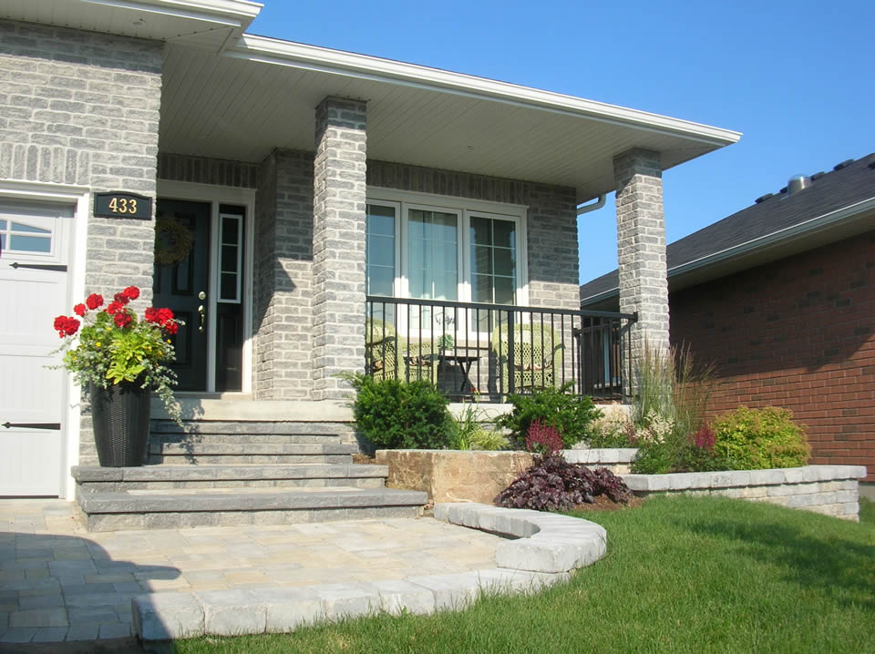 Residential entrance with tiered planters