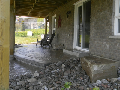Walkout basement with Sienna steps, interlock patio and natural stone