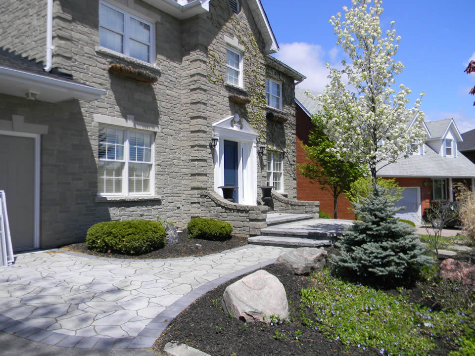 Entrance with Mega Arbel paver and raised landing and ornamental pear tree
