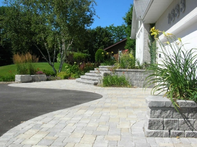 Driveway apron with planter, steps and natural stone