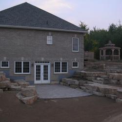 Walkout basement with limestone tiered retaining walls