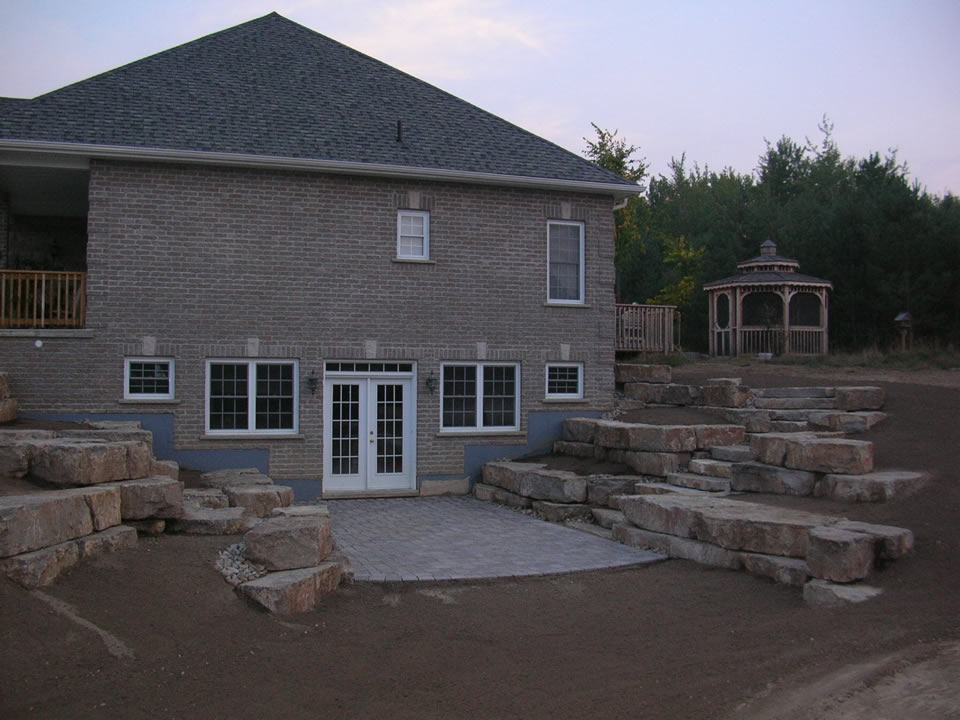 Cavan hills landscaping retaining walls for Walkout basement backyard ideas