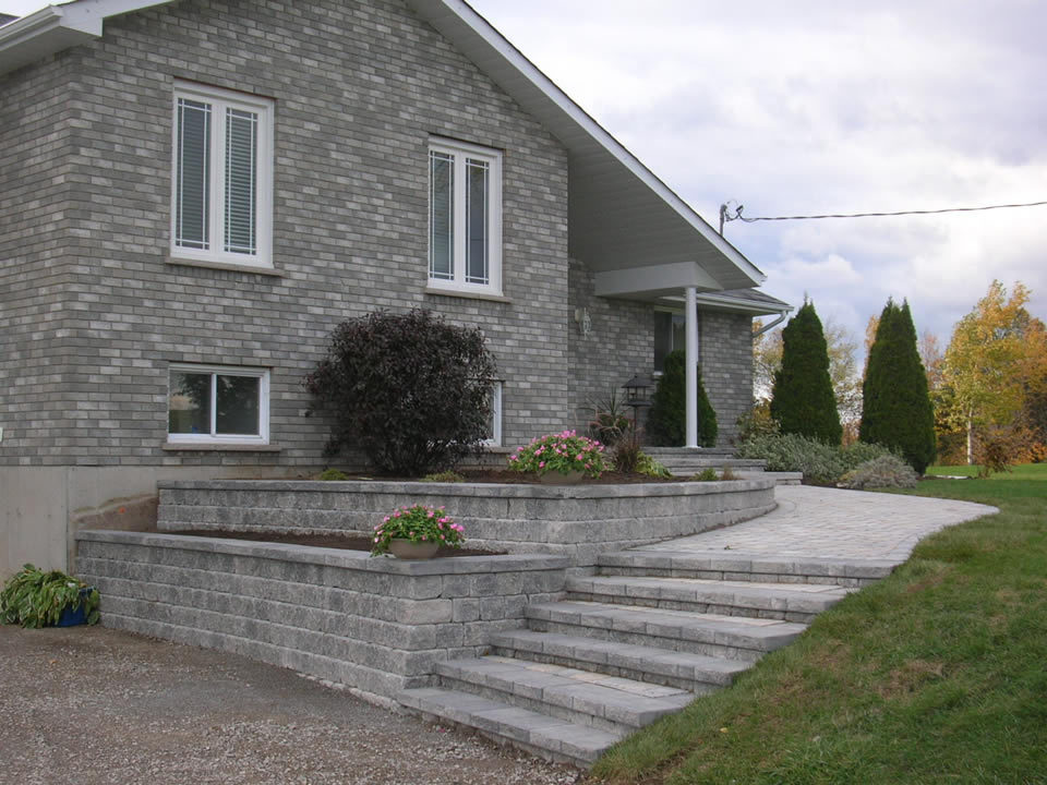 Entrance with tiered retaining walls