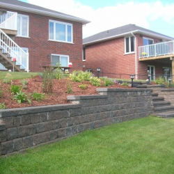 Step down retaining wall