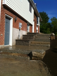 Natural Stone steps and terraced planter walls
