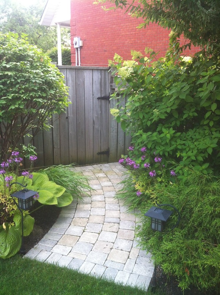 running bond, tumbled walkway with mature garden