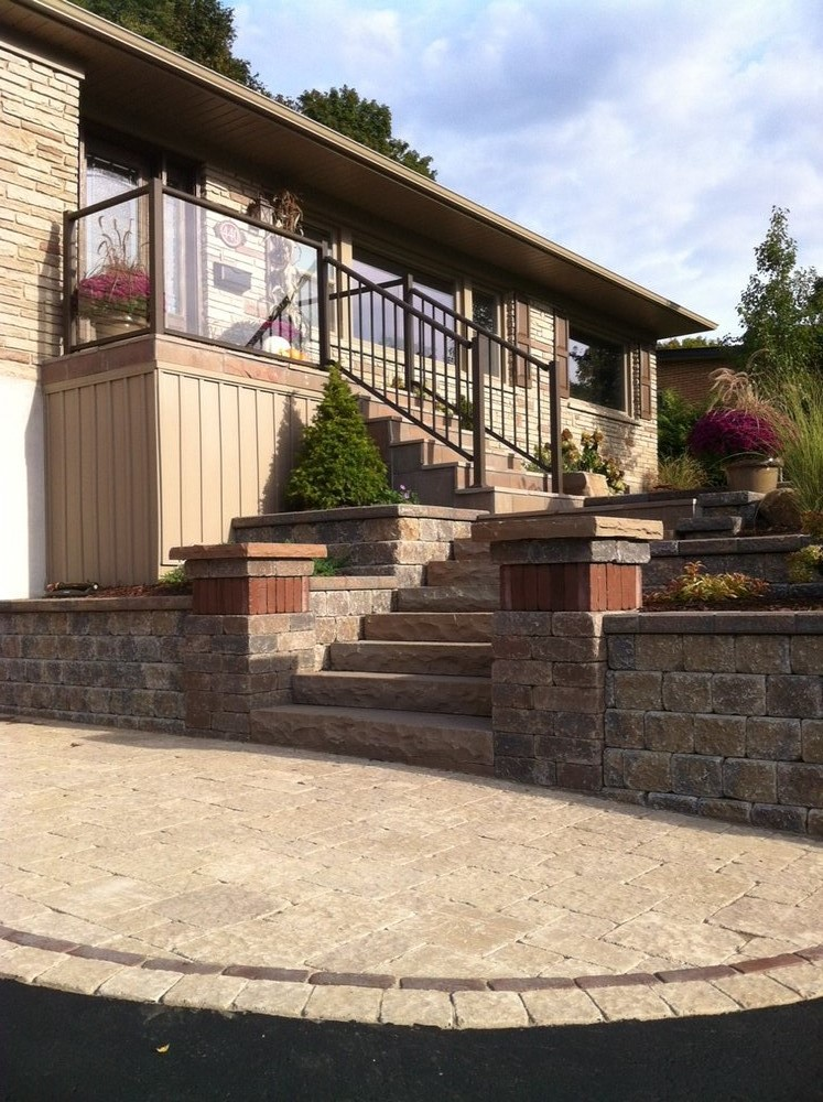 Natural Stone steps with terraced planters and pillars
