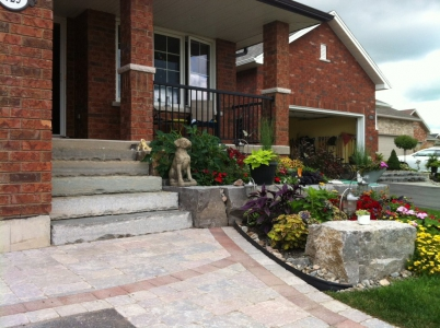 Natural stone steps with Armour stone planter wall and Interlocking stone apron