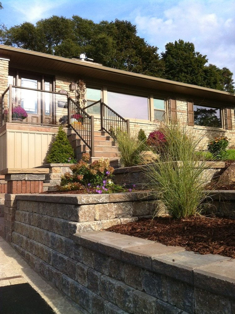 Tumbled gardens walls with pillar and plantings
