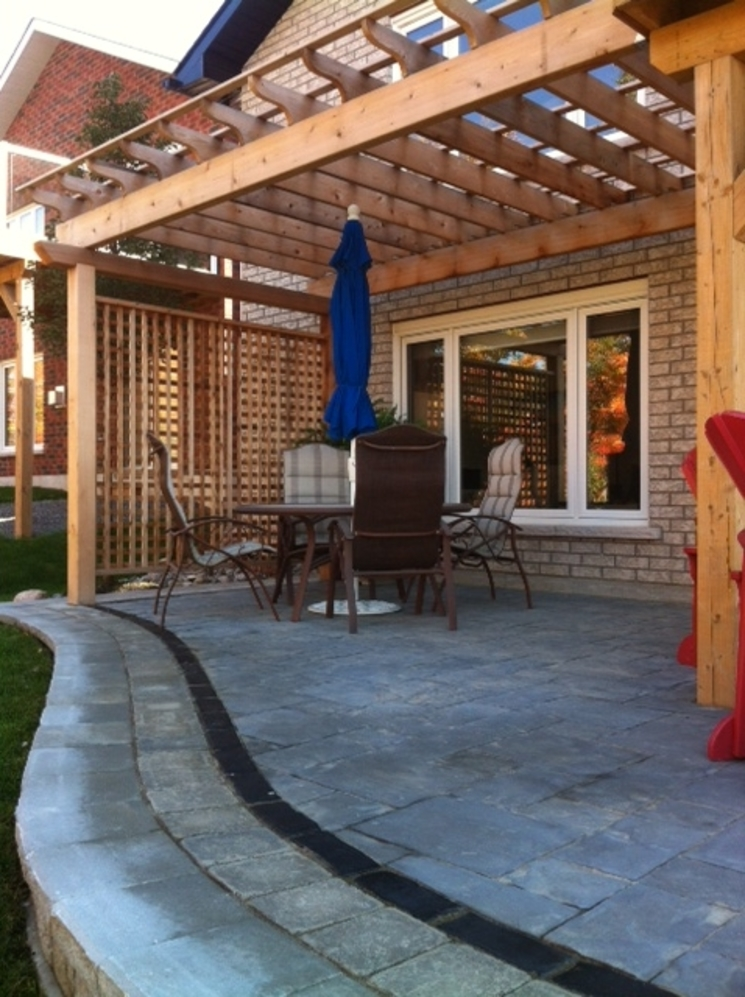 Stone patio and Cedar Arbour with privacy screen